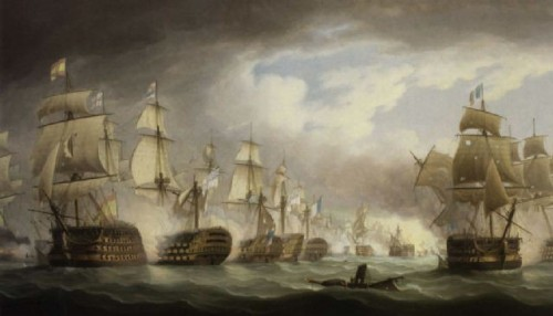 """The painting HMS """"Victory"""" Heavily Engaged at the Battle of Trafalgar by Thomas Buttersworth. A naval battle between British and Spanish galleys on a dark, choppy sea. The galleys are lined up along a vanishing point terminating in the lower right third of the painting. The left sky contains dark clouds, the right sky is clearing and sunny."""