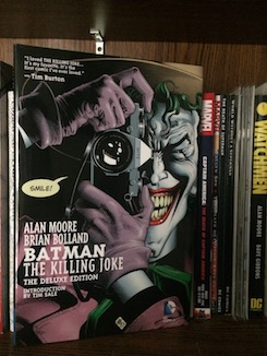 Photo of the book Batman: The Killing Joke on a bookshelf.