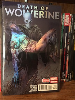 Photo of the comic book cover for Death of Wolverine #4 on a bookshelf.