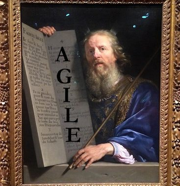 "Photo of the painting ""Moses Presenting the Tablets of Law"" (1648) by Philippe de Champaigne with the word AGILE written over the tablet closet to Moses."