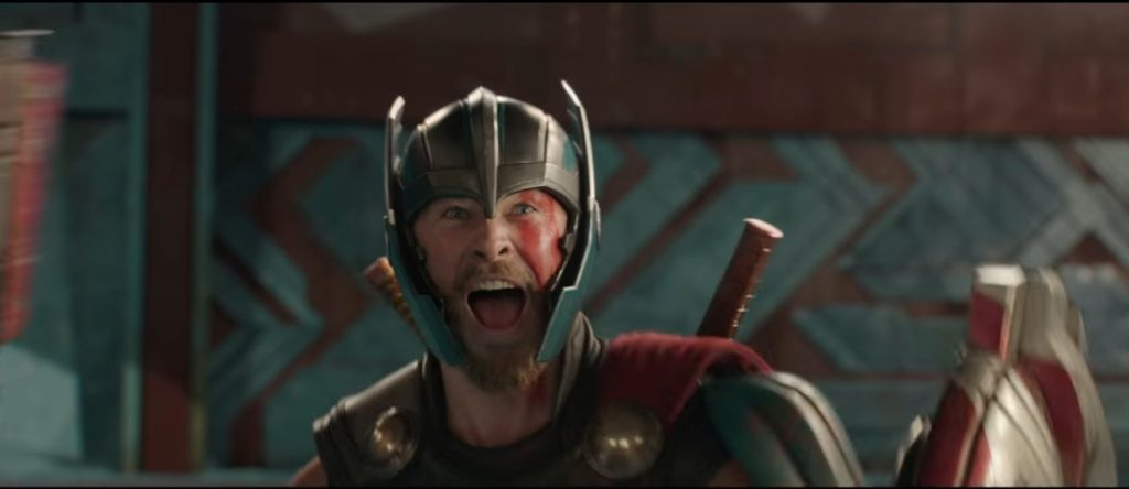 Movie still of Thor happily exclaiming joy. From Thor Ragnarok.